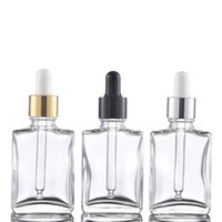 Hot Sale 400pcs Lot 30ml Transparent Glass Dropper Bottles 1OZ Essential Oil Cosmetic Container with Silver Gold Black Lids