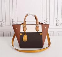 높은 품질 여자 가방 패션 트렌드 가방 Luxurys 디자이너 가방 가방 새 어깨 순 캐주얼 휴대용 여자 가죽 가방 광장 슬링 LM22