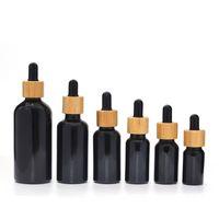 UV-Proof-lichtdichte natürliche schwarze Glasmaterial-Tinktur-Tropfflasche mit Bambusdeckel 10ml 15ml 30ml 50ml 100ml ätherische Ölflasche