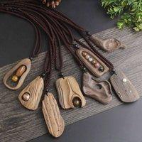 Estilo étnico retro longo camisola colar europeu e americano simples artesanal roupas de madeira pingente