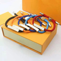 Braccialetti del braccialetto del braccialetto unisex per i monili del braccialetto regolabile della donna dell'uomo 5 colori con la scatola