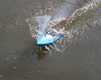 urnedstar 2.4 جيجا هرتز 4ch 25 كيلومتر / ساعة عالية السرعة سباق rc قارب سبيد السفينة سفينة مع نظام تبريد المياه انقلبت للطفل اللعب هدية