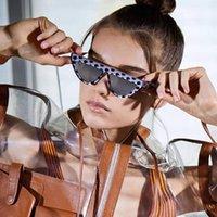 2020 New Comércio Exterior Moda pequeno quadro Triângulo Cat Eye óculos de sol Mulheres Roxo Dot Flat Top óculos Unisex Trends