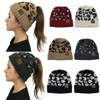 Mode pour dames Automne et Hiver torsadé imprimé léopard Ponytail creux Top Bonnet tricoté chaud coupe-vent extérieur Woollen Hat