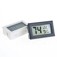 FY-11 MINI MENCIMIENTO DIGITAL LCD Entorno Termómetro Higrómetro Humedad Medidor de temperatura en la habitación Refrigerador Icebox negro / blanco DHL gratis