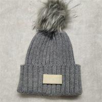 New Pom Winter New Women Warm Woolen Hat Designer Punto Mujeres Sombreros Venta de Hot Venta de Gorros de Moda Envío Gratis