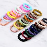 10 teile / satz Spiralform Haarkrawatten geschliffene elastische Haarbänder Mädchen Accessoires Gummiband Headwear Gum Telefon Draht Haarseil M928