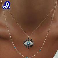 Glückliches Auge Turkish Evil Eye-Anhänger-Halskette Legierung Goldfarbe langkettige Double-Layer-Halskette für Frauen Mädchen Schmuck LE525