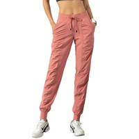 Pantalones de yoga cordón cintura elástica joggers trajes deportes sueltos ajuste transpirable ropa de gimnasio mujeres pantalón corriendo en el bolsillo de la aptitud Casual general medias