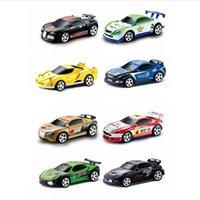 8 colores 20km / h Coca Cáscara Mini RC Radio Radio Control remoto Micro Racing Coche 4 Frecuencias Juguete para niños Regalos de Navidad RC Modelos 201203