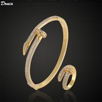 Donia joyería de lujo brazalete fiesta europeo y americano moda uñas titanio acero micro-incrustado circón pulsera anillo conjunto regalo de diseñador
