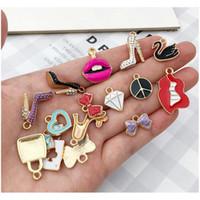 55pcs / pack Multistyle DIY pulseira Colar encantos pingentes bonitos diy jóias fazendo acessórios componentes sqcpnu rainha66