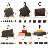 Venda por atacado um número de carteiras masculinas e femininas de alta qualidade Longo zíper curto de couro em relevo com cartão de caixa 26 cores