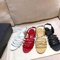Europe 2021 new summer leather Korean version all-match peep-toe beach shoes Roman buckle flat strap sandal women trend