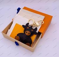 No Box Flowers Keychain Carino Bovini Cartoon Bowknot Design Handmade Auto Portafoglio Auto Borse Pendente Portachiavi in pelle Unisex Animale Catena chiave