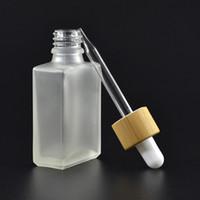 30ml clair / verre givré goutte Bouteilles liquide réactif Pipette carrés Essential bouteilles de parfum L'huile de fumée liquide e bambou Cap DWF2400
