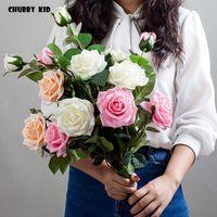 Dekoratif Çiçekler Çelenkler 6 adet / grup! Toptan gerçek dokunmatik 3 kafa yapay silikon gül nemlendirici uzun dal / kök keçe