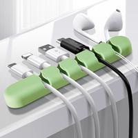 5 ranuras del organizador del cable USB clips de gestión de cables sostenedor de la devanadera 3M pegamento para el teléfono del cable de carga del cable de línea de datos para auriculares Ratón