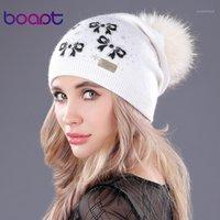 [BOART] лук вязаные кашемировые колпачки натуральные подлинные еноты меховые помпоны хлопок мягкие женщины зимние шляпы женские Gorros Caps beailes1
