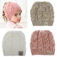 Enfants Filles Ponytail Bonnet Chapeaux Tricotés enfants Chunky Skull Caps Câble d'hiver en tricot crochet dégoulinent Chapeaux Mode Chapeaux pour le sport en plein air