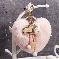 귀여운 pompom 키 체인 진주 술 솜털 솜털 플러시 가짜 토끼 모피 열쇠 고리 여성을위한 소녀 심장 가방 매력 펜던트