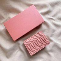 مدمجة الجيب المنظم الرجال النساء مصمم الأزياء قصيرة فاخرة متعددة محفظة مفتاح حامل بطاقة عملة جلد أسود MIU N63143