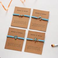 La moda del corazón del delfín azul trenzado pulseras de cadena de la cuerda para las mujeres turquesa tortuga de cinco estrellas Infinity Charm brazalete de joyería con tarjeta de regalo