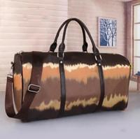 2021 55 سنتيمتر سعة كبيرة المرأة حقائب السفر بيع جودة النساء الرجال الكتف أكياس القماش الخشن تحمل على الأمتعة أسفل المسامير مع قفل الرأس