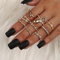 En forma de serpiente con diamantes incrustados pentagrama tallado de imitación Opal 9-piezas venta al por mayor Anillo