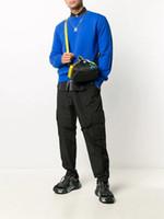 Nouveau Sac de voyage en nylon Courir Fitness Hommes Sac Messenger Courroie Jaune Bande Populaire Marque Sacs Multi-fonction Sacs Cross Body Sac pour hommes