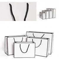 DHL envía Papel Kraft Bolsas espesa blanca Tarjeta de empaquetado Bolsa de almacenamiento Publicidad Moda Partido bolso de las compras la ropa personalizada 1