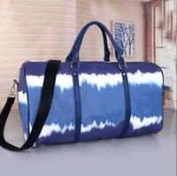 2021 50cm Grande Capacidade Mulheres Viagens Sacos de Venda Mulheres Mulheres Homens Ombro Duffel Bags Levar Rebites Bottom Back Com Bloqueio de Bloqueio