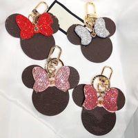 Nueva diamante LLAVERO diseñado por los mejores diseñadores, llavero ratón de dibujos animados de cuero de alta calidad, regalo de la pareja, colgante del bolso de la mujer, colgante llave del coche
