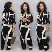 Jumpsuit de moda para mujeres Dot Black Blanco Rompers Botón Arriba Bolsillos con cinturón para mujer Romper