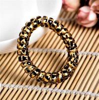 Bandas de leopardo en color Teléfono Alambre cable banda para el cabello de goma de chicas WomenScrunchies lazo del pelo pulsera elástica pelo Scrunchies cuerdas del anillo LY10162