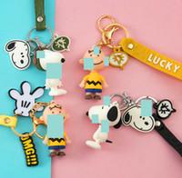 Corea creativa de la cadena dominante de la historieta pequeña pendiente lindo Snoopy llave del coche adornos bolsa de hombres y mujeres parejas de cadena colgantes