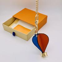 الرجال النساء مصمم المفاتيح الأزياء الساخن الهواء بالون الجلود الحلي حقيبة محفظة مفتاح قلادة مشبك الملحقات السنة الجديدة هدية مع مربع