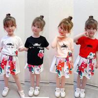2021 الصيف أطفال الرياضة تتسابق الأطفال إلكتروني مطبوعة قصيرة الأكمام تي شيرت + الزهور مطوي التنانير 2PCS مصمم الفتيات مجموعات A5511