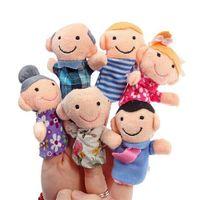 12pcs / lot dedo de la familia de las marionetas SET de la mini felpa del bebé de juguete Niño Niña Finger Puppets Educativo Historia mano de las marionetas de tela juguetes de la muñeca