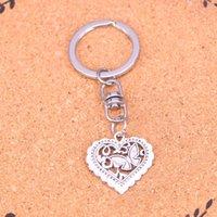 Mode Keychain 25 * 24mm Les pendentifs coeur papillon bricolage bijoux voiture porte-clés Anneau Porte-cadeau souvenir pour