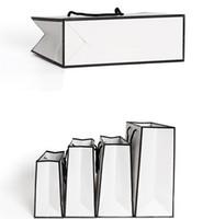 التسامح الأزياء الأبيض كرافت ورقة حقيبة يد جيد الثقيلة حمل حزمة الملابس الحذاء كاب هدية التعبئة والتغليف التفاف 1 86gr L2
