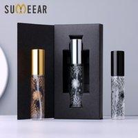 50 Pz / lotto 10ml Bottiglia di profumo di vetro portatile da 10ml con scatola di imballaggio Atomizzatore Vuoto Vuoto Mini Bottiglie ricaricabili Cosmetici
