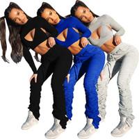 Frauen Stacked Hosen stellten beiläufige Normallack aushöhlen Langarm Stehkragen Zweiteiler Jogginganzüge Mode Damendesignerkleidung