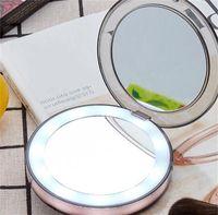 Kosmetische Spiegel Makeup-Objektiv Compact Hand USB-Lade-LED-Faltspiegel Berührungsempfindliche Schalter Small Light Intelligenz Tragbare neue 32xy m2