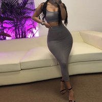 KGFIGU 2020 New Arrival Women's Solid Color Fashion Suspender Wrap Chest Top Sexy Tight Lifting Hip Long Skirt Two-piece Set LJ201126