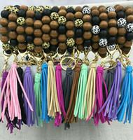 عبر الحدود الإبداعية متعدد الألوان اليدوية الخرزة خشبية سوار الكورية المخملية الشرابة قلادة سلسلة المفاتيح