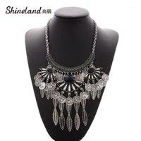 Ketten Shineland Vintage ethnische Zigeuner tibetanisches Großmetall-Lätzchen-Übertreibung Geometrische Quaste-Münze Blätter Halsketten Anhänger für Frauen1