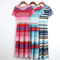 910 2020 Marka Aynı Stil Elbise Kısa Kollu Mürettebat Boyun Bayan Giysileri Flora Baskı Kint Elbise Diz Yukarıdaki Lüks Moda Elbise DL