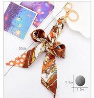 جديد الجلود والأوشحة الشريط فراشة مفتاح سلسلة bowknot الديكور الشرابة حلقة رئيسية المرأة حقيبة مجوهرات قلادة CH3596 H jllzvw