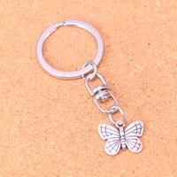 Mode Keychain 18 * 14mm à double papillon face pendentifs bijoux bricolage voiture Porte-clé Anneau Porte-cadeau souvenir pour